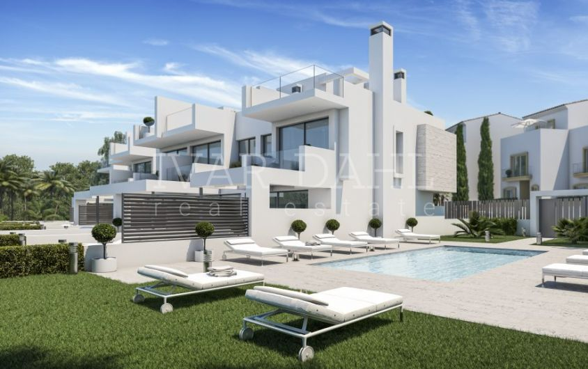 New development of modern townhouses on the beach in Estepona, Malaga