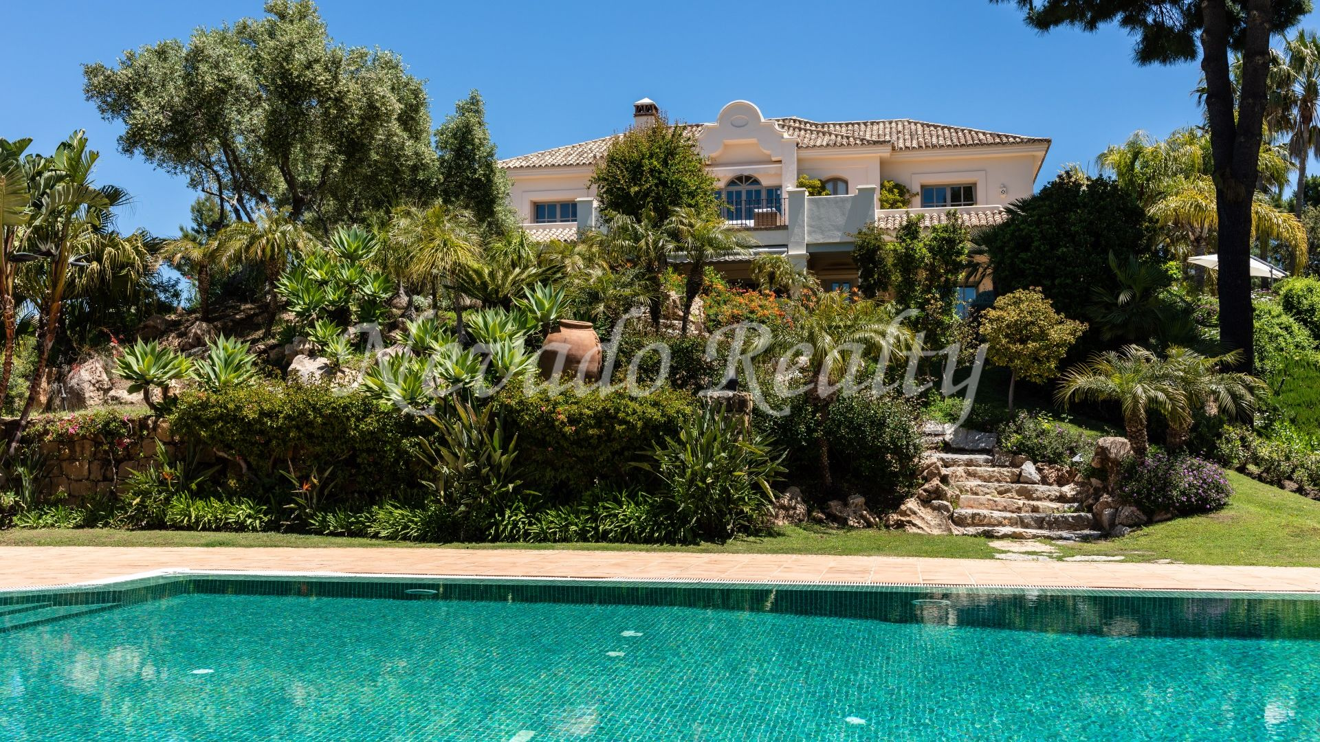 Colonial style villa for sale with a large plot and views to the golf course in Marbella