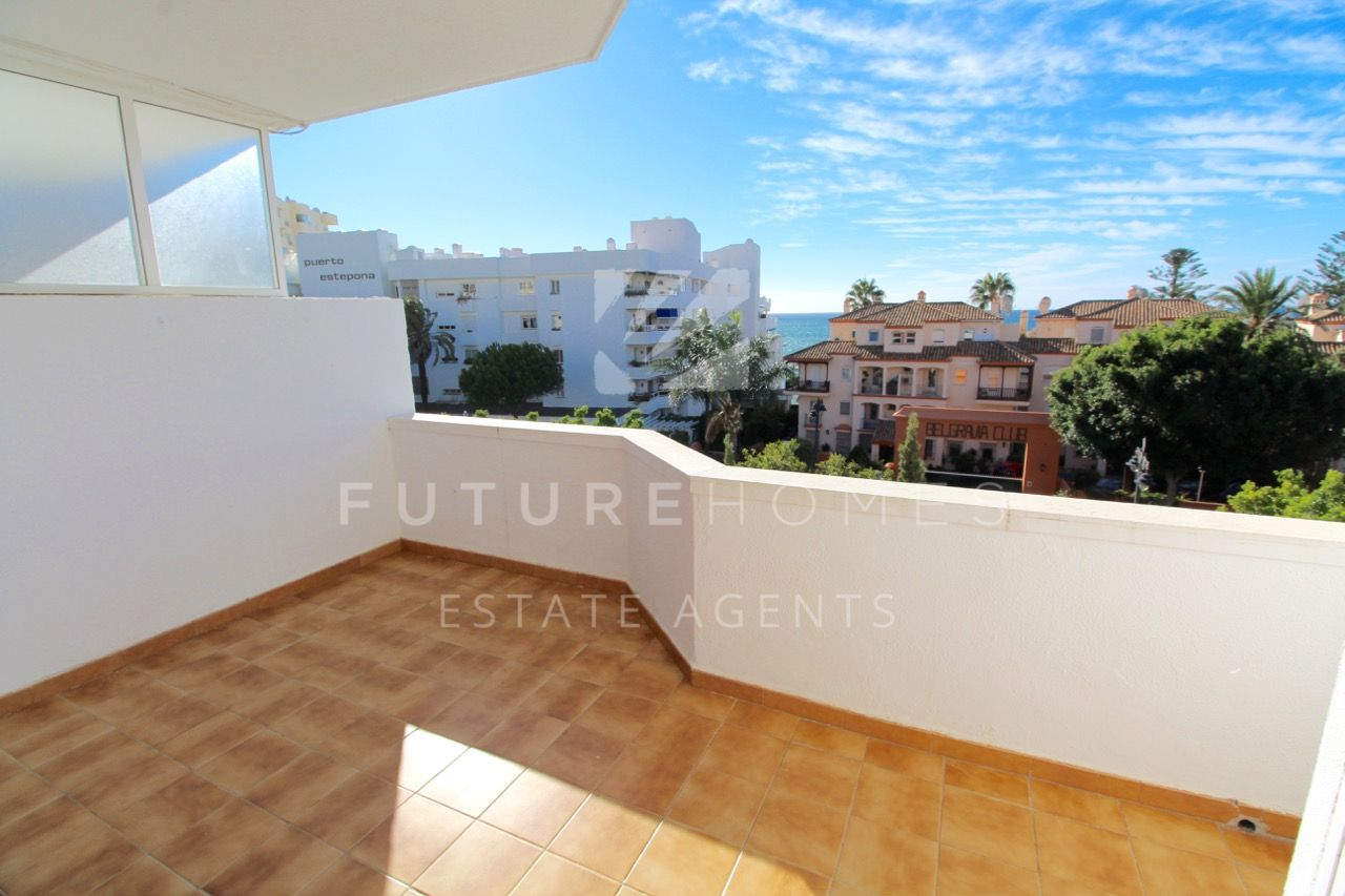 Sunny penthouse apartment for sale next to Estepona marina
