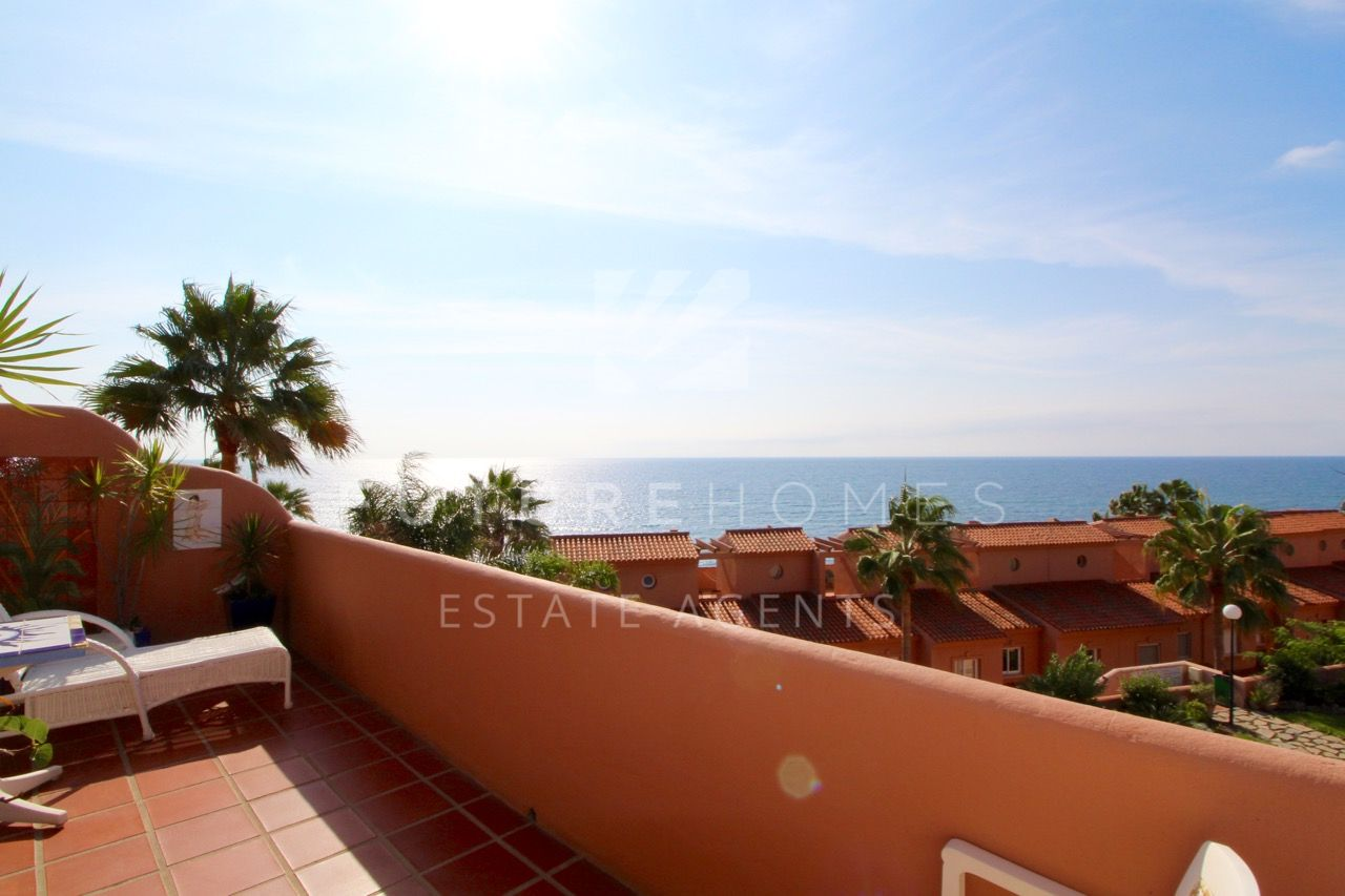 Spacious corner duplex penthouse only two km to Estepona port on frontline beach community in Playa Azul