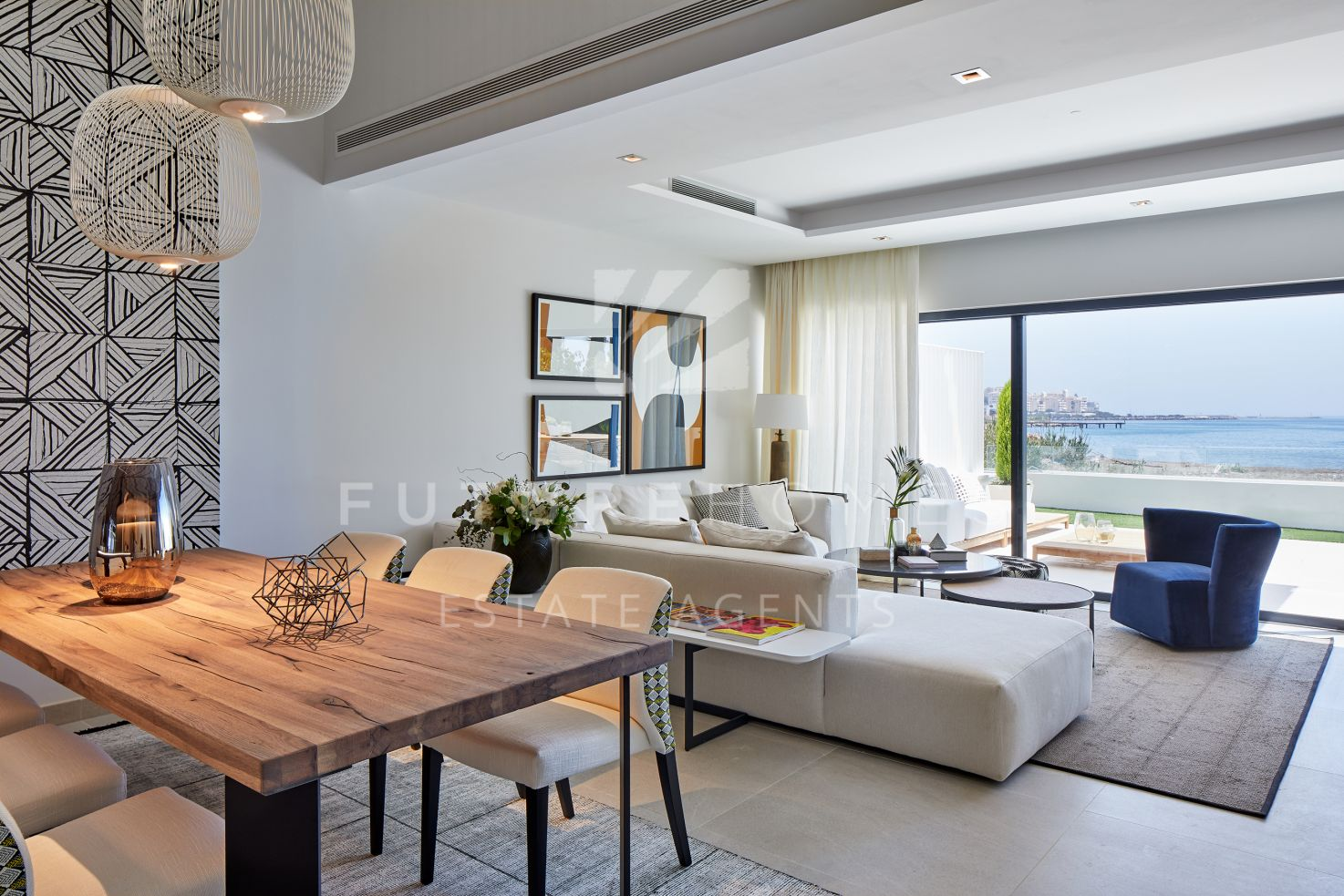 Exclusive frontline beach townhouses in West Estepona