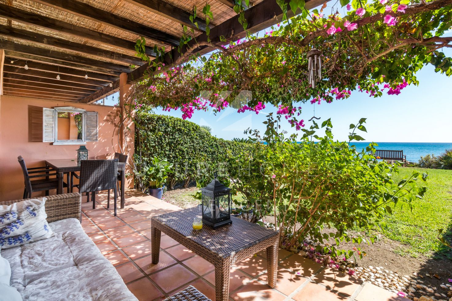 Front line beach townhouse with spectacular sea views near Estepona port!