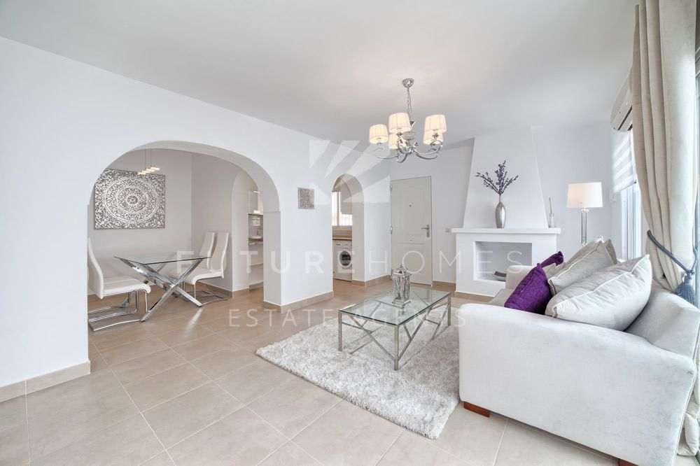Renovated Spanish style townhouse on frontline beach community.