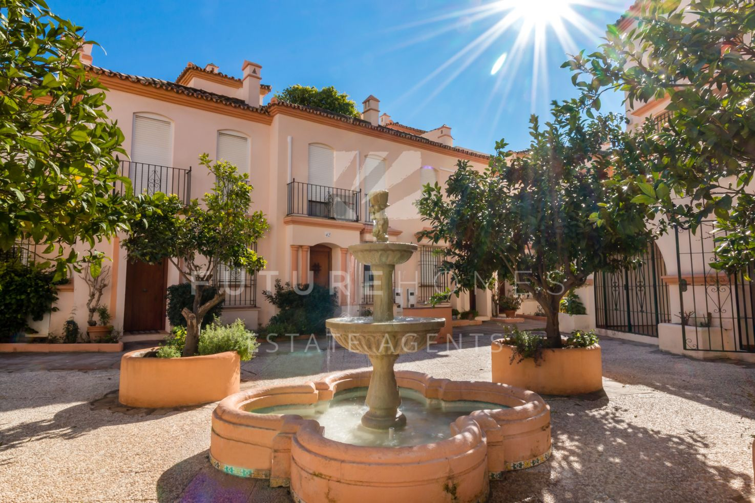 Front line beach townhouse in Belgravia Club next to Estepona port
