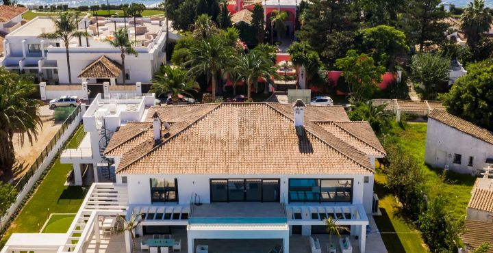 Beach side luxury 6-bedroom villa for sale in Casasola, Estepona