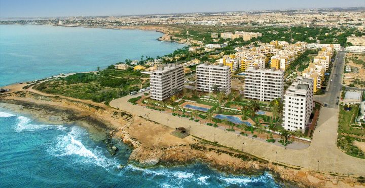 Contemporary frontline beach apartment for sale in Punta Prima, Costa Blanca South