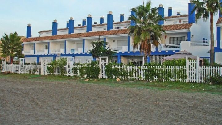 Estepona, Front line beach townhouse for sale in El Saladillo, Cancelada