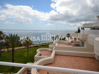 Beautiful totally refurbished front line beach 4 bedroom 2 bathroom apartment, 80m2 terrace with sea views in sought after complex between Estepona and Casares/Manilva. Newly fitted double glazing throughout.   Sold partially furnished.  Padel court and s