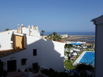 Marbella East, Duplex apartment overlooking the pretty Puerto Cabopino in Marbella East