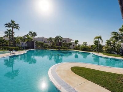 Benahavis, Ground floor garden apartment with stunning views of the golf course and Mediterranean Sea