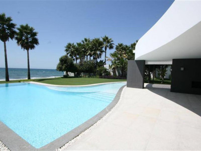 Marbella, Unique contemporary beachfront villa in Marbella with infinity pool and direct access to the beach