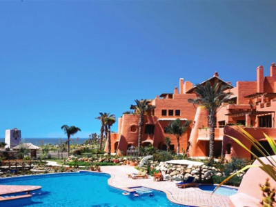 Estepona, Stunning duplex penthouse apartment in Estepona with Mediterranean sea, pool and garden views.