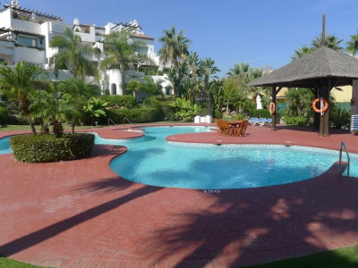 Marbella - Puerto Banus, Fabulous beach front apartment property in Puerto Banus with tropical gardens and sea views
