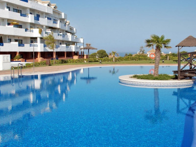Manilva,**BIG REDUCTION** Ground  floor  sunny  apartment  with  private  garden  for  sale  in  Duquesa