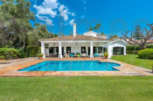 A charming and spacious villa for sale overlooking a green area in a quite road in Sotogrande Costa