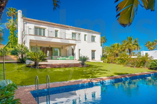 A 3 storey modern andalusian family villa with views to La Reserva, Valderrama and the mountains.