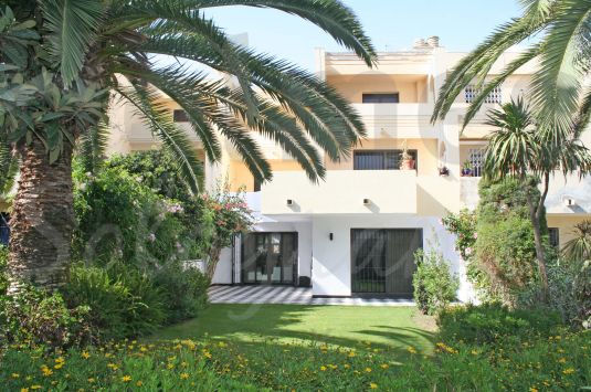 A fully renovated ground floor apartment in Jardines de Sotogrande with a secluded south facing garden and communal pool.