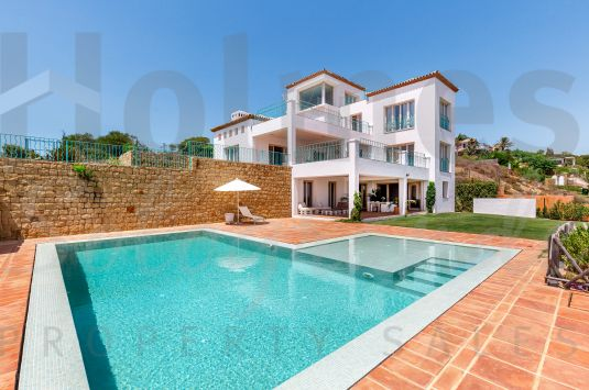 Fantastic villa located in La Reserva with breathtaking panoramic views across Sotogrande to the sea, Gibraltar and Morocco .