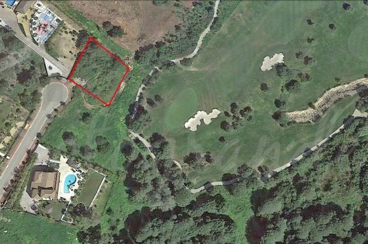 A Sotogrande building plot with full outline planning permission for a detached single family dwelling.