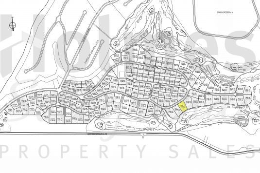 A building plot with full outline planning permission for a detached single family dwelling in La Reserva de Sotogrande.