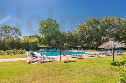 Partially renovated 2 bedroom apartment in Casas Cortijo with views across the communal gardens towards the 9th green of Valderrama.