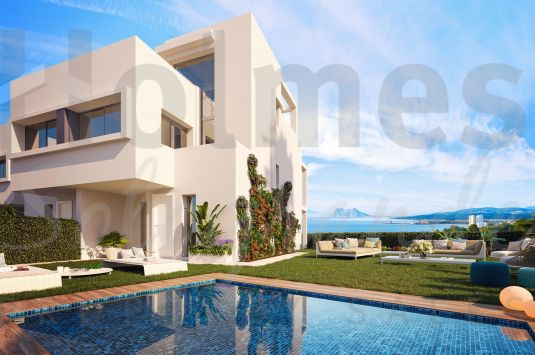 Modern style corner townhouse in a new complex with spectacular sea views of Gibraltar and the Moroccan coastline.