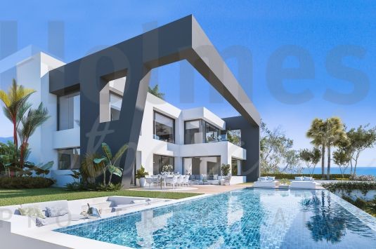 Unique contemporary 4 bedroom villa in the sought after residential area of La Paloma and with spectacular views of the coastline from Marbella to Gibraltar form every room.
