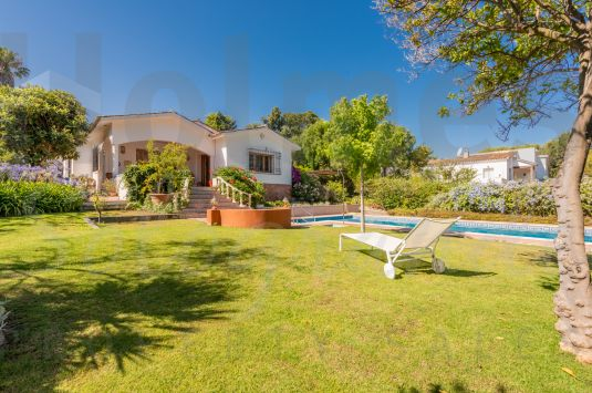 Charming 2 storey family home in a mature area of Sotogrande Costa with plenty of trees and scope for refurbishment.