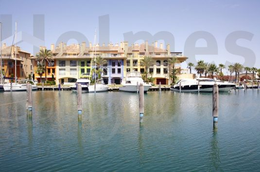 A first floor apartment with spectacular views over the Sotogrande marina.
