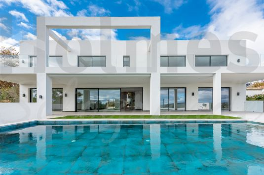 Spectacular modern style east facing villa with fabulous mountain and sea views.