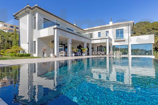 Spectacular south-facing 3 storey front line golf villa in La Reserva with panoramic golf and sea views.