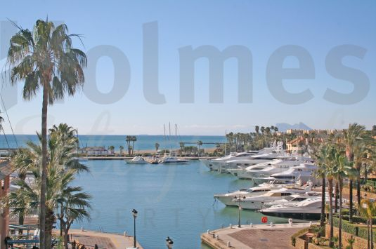 Magnificent and totally renovated south-facing penthouse in Puerto Deportivo de Sotogrande with views to the sea, Gibraltar and Africa in the distance.