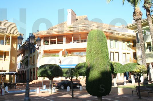 Southeast facing leasehold second floor 2 bedroom apartment with views over Plaza de los Naranjos towards the Marina.