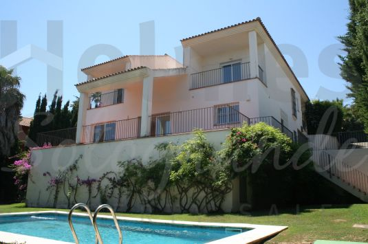 A substantial villa built around a central patio with views towards Valderrama Golf Course.