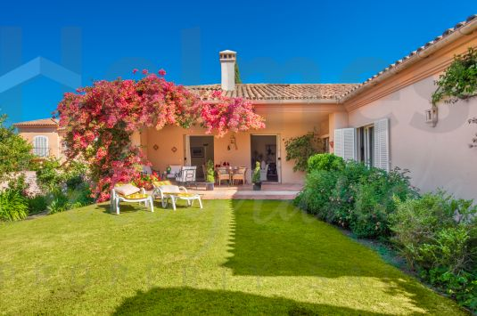 A south-facing charming rustic style semi-detached house in the prestigious and peaceful Patios de Valderrama, adjacent to the Valderrama Golf Course.