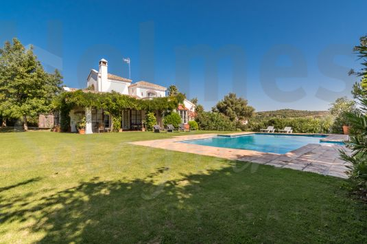 Lovely south-facing 3 storey family villa located in a mature area of Sotogrande Alto with views to the sea and La Reserva Golf Course