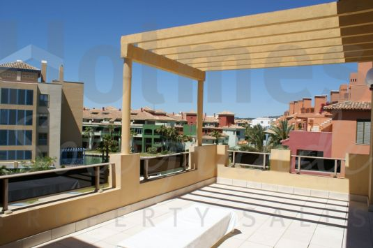 A furnished penthouse apartment in the Marina with a very sunny aspect and pleasant views.