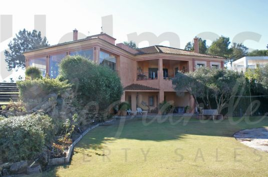 Elegant rustic style villa with great views to La Reserva golf course and the sea in the distance.