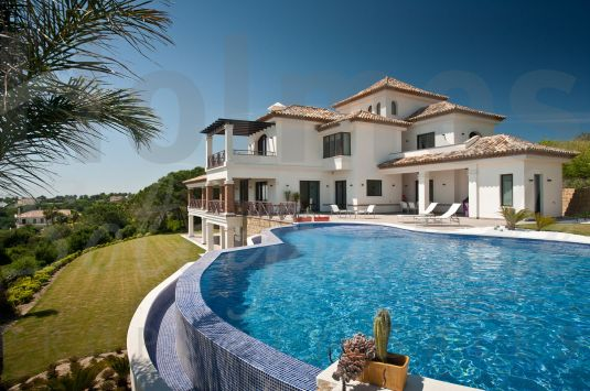 A stunning property built to very high specifications with panoramic sea and mountains views.