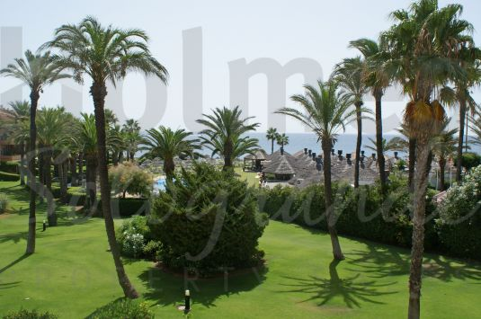 A second floor apartment with superb views over the gardens, beach club to the sea.