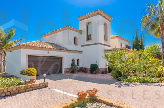 Elegant family villa with stunning panoramic sea views over 2 golf courses and the mountains beyond.