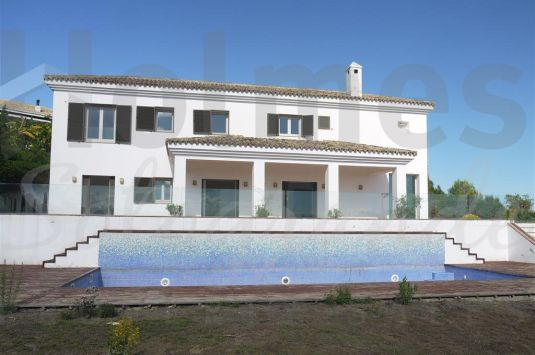 Unfurnished villa in La Reserva with great views over Sotogrande to the sea and Gibraltar in the distance.