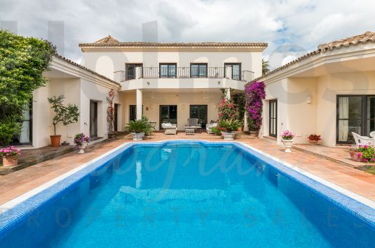 Fabulous villa with views to the golf and the sea with super family accommodation.