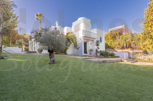 This well preserved multi-level villa is situated in the heart of Sotogrande Costa and bordering a green zone.