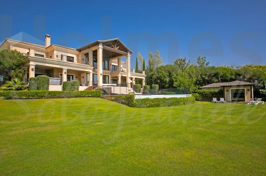 A stunning villa with majestic views over 3 golf courses to the sea and the mountains.