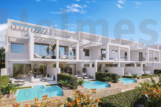 Modern style townhouse in a new complex with spectacular sea views of Gibraltar and the Moroccan coastline.