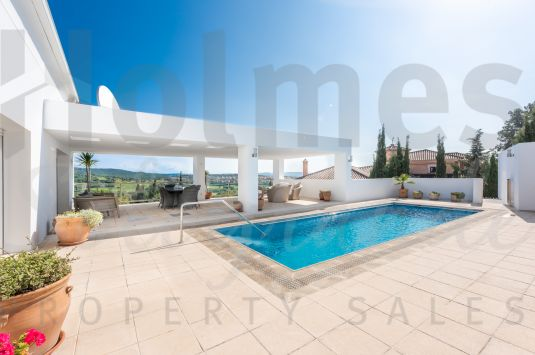 This modern unique style villa offers spectacular panoramic views to La Reserva Golf Course, the mountains and the sea.