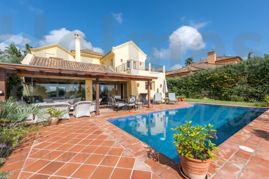 A really charming villa set in pretty gardens with a lovely southerly aspect and fabulous golf and sea views.
