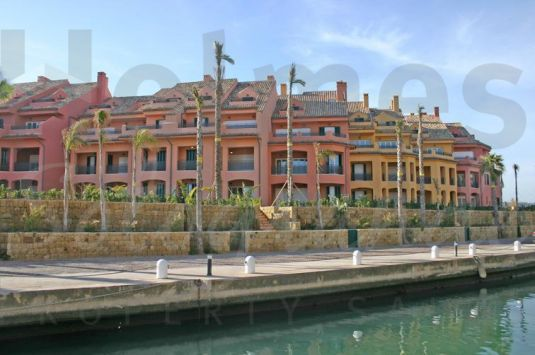 Unfurnished luxury first floor apartment with fabulous southerly views directly over the Marina to the sea
