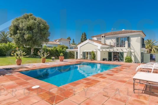 Pretty villa in a quiet location with private south facing garden and pool.